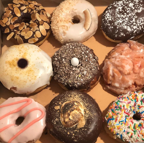 variety pack of decorated donuts in a box