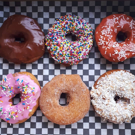 variety pack of donuts on checkered liner top view