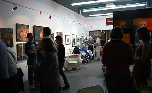 art gallery with people during art show