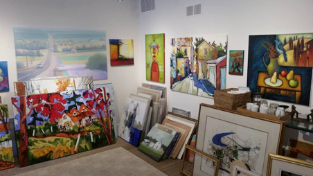 interior of art display in gallery with various pieces of art
