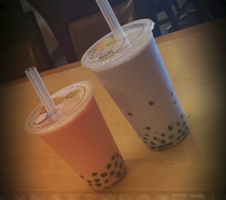 pink and purple bubble tea on counter diagonal view