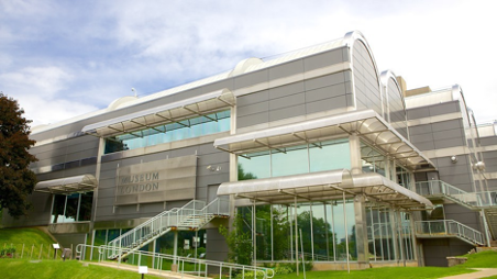 outdoor view of multi story museum on cloudy day with stairs near front entrance