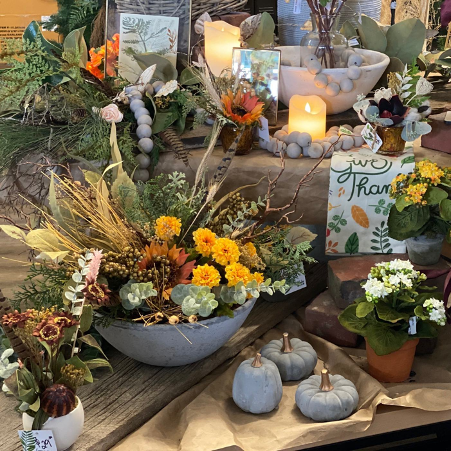 greenery on display at home decor store with green and fall colours