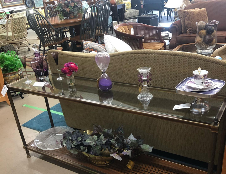 glassware on display in home decor store staged as living room