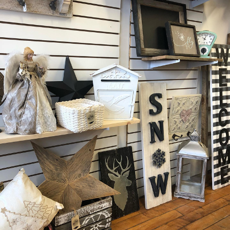 wooden modern home decor on display on shelves in store
