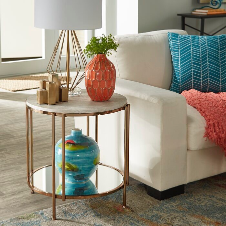 pink and blue vases on side table beside couch