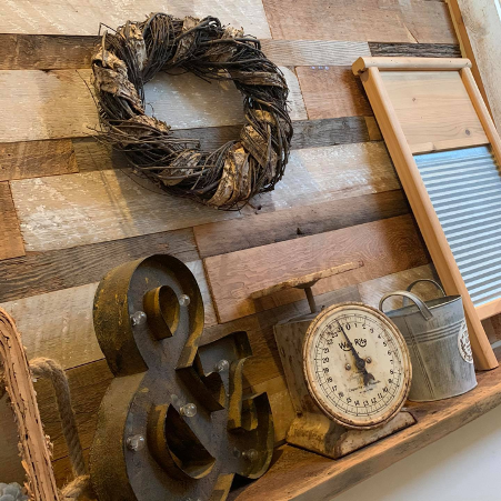 wooden decor on display in store against wooden wall