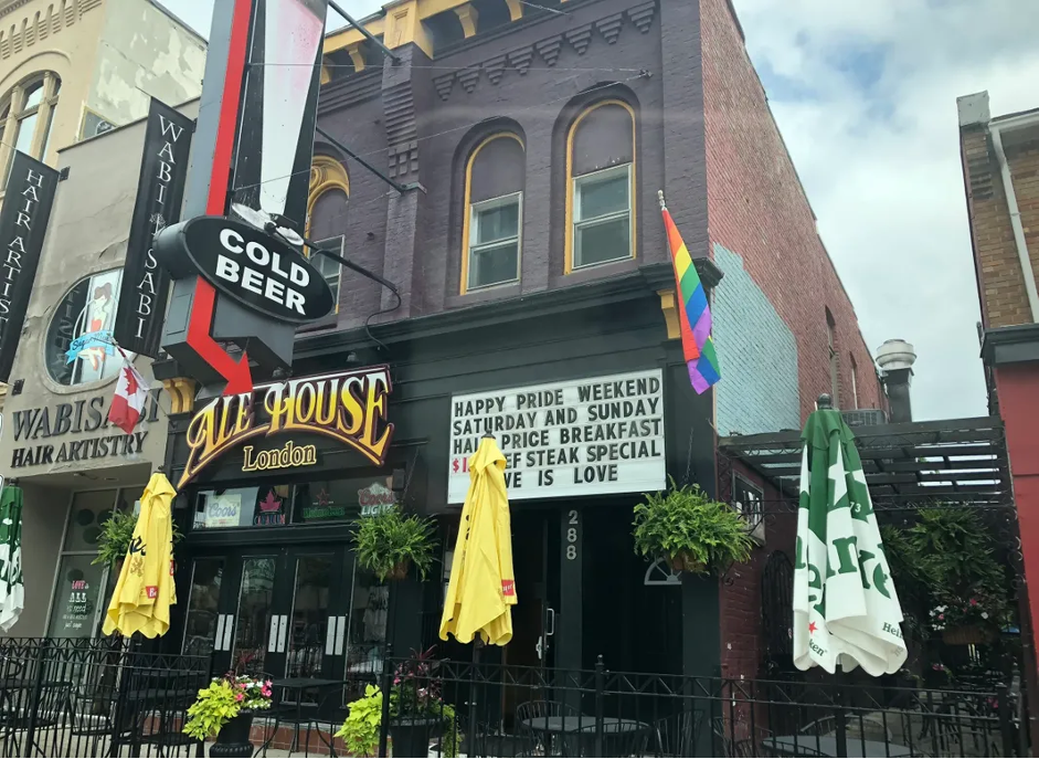 exterior of pub with outdoor patio and yellow umbrellas