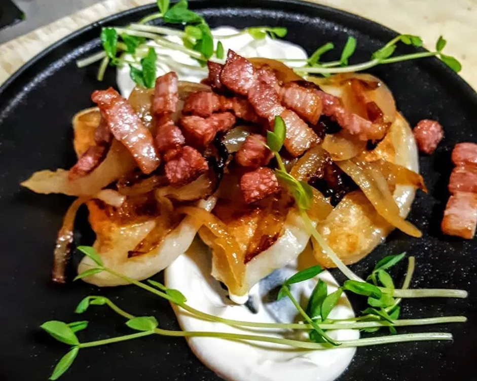 high end presentation perogies with bacon, onion and sour cream