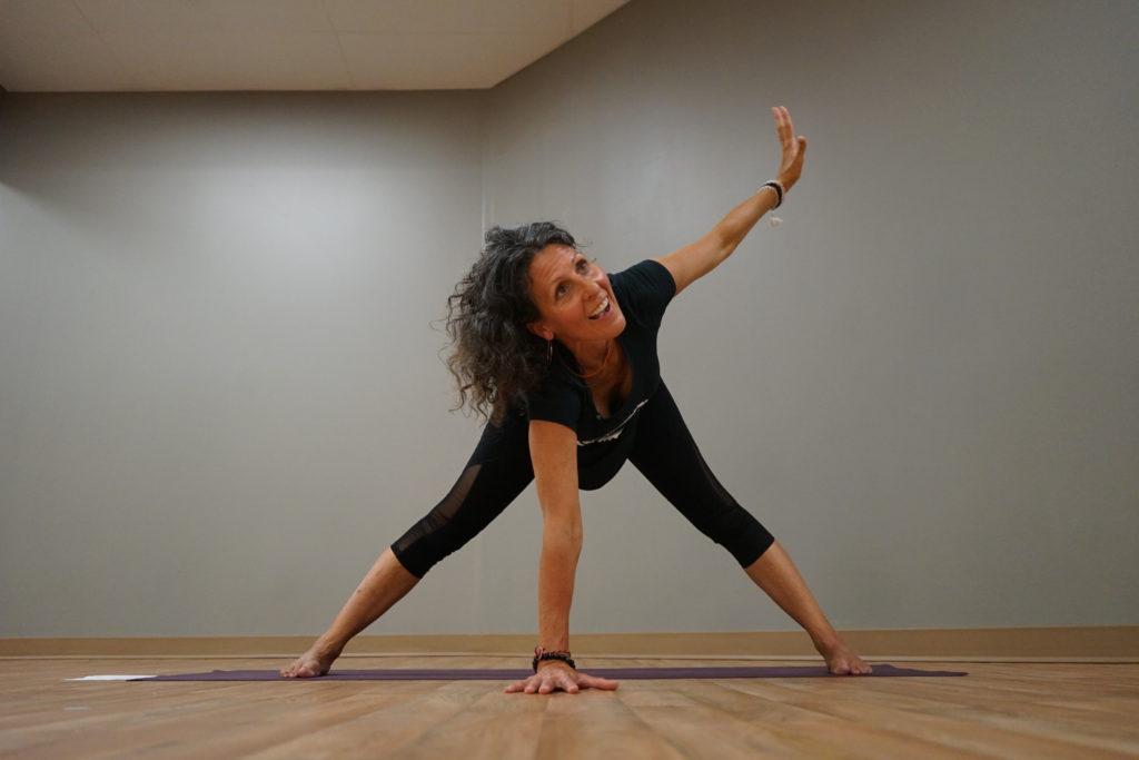 woman doing yoga in empty studio