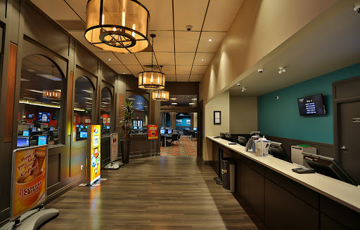 view of service counter at casino type establishment with hardwood floors, private rooms overlooking large room