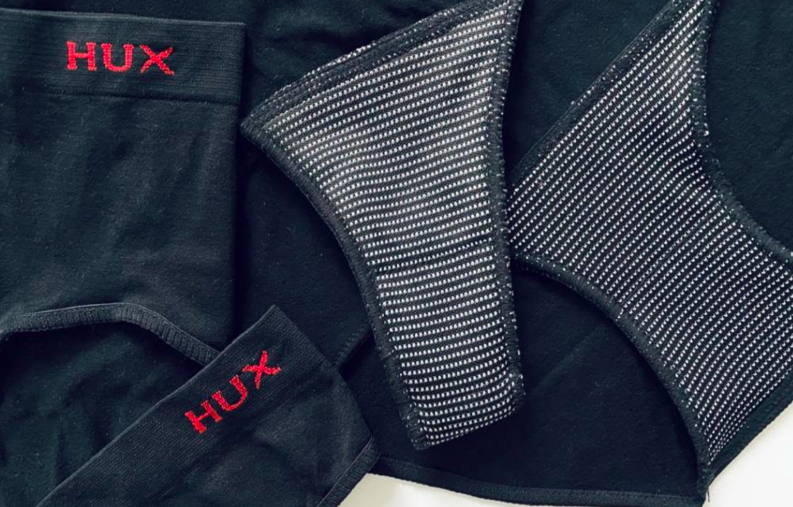 set of underwear showing absorption layer with branding on the left side of all underwear
