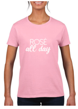 woman modelling a pink graphic tee that reads rose all day against a white background