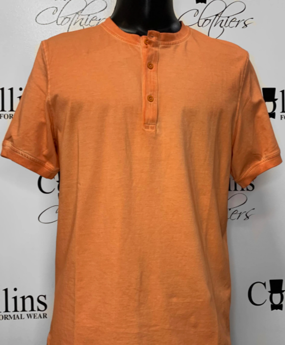 mens orange tee shirt with three buttons at the top being modelling by manekin against a photo backdrop with branding all throughout