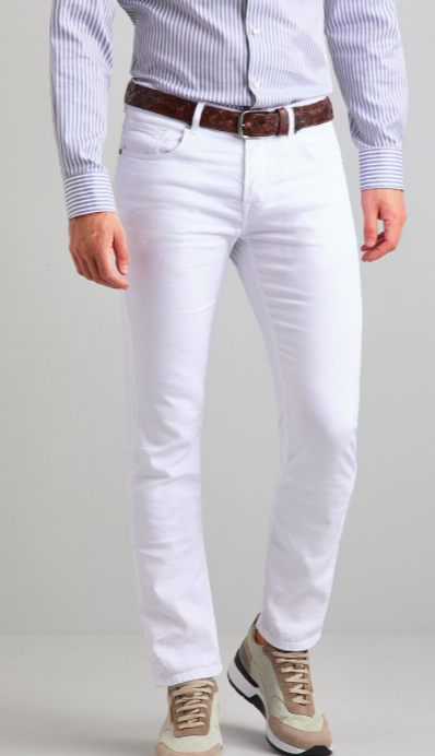 man wearing white jeans with one leg slightly raised with upper body not exposed against a white background