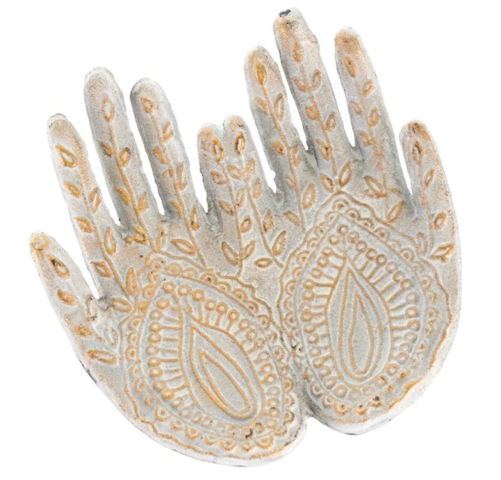 garden ornament shaped liked hands with gold texture throughout
