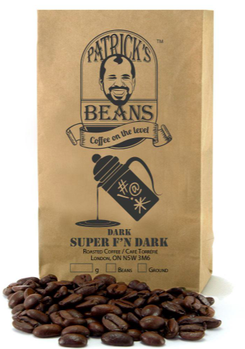 small brown paper bag of whole coffee beans with some displayed on the front