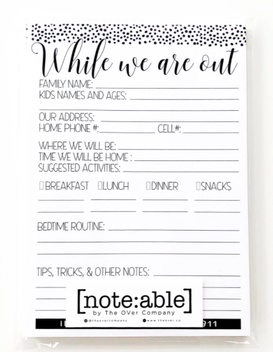 mid sized note pad made for babysitters with family details on notepad