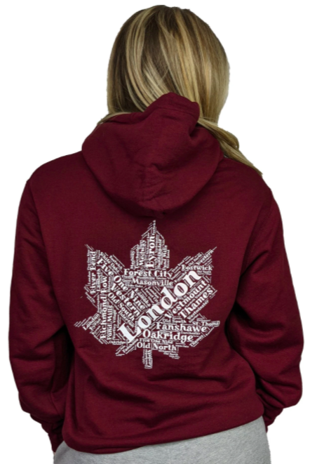woman modelling maroon sweater with a maple leaf on the back made up of words not facing the camera