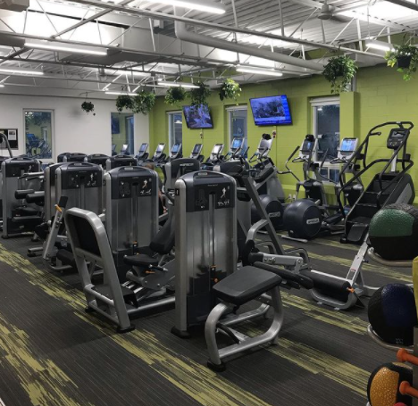 Interior of a gym facility with various pieces of workout equipment