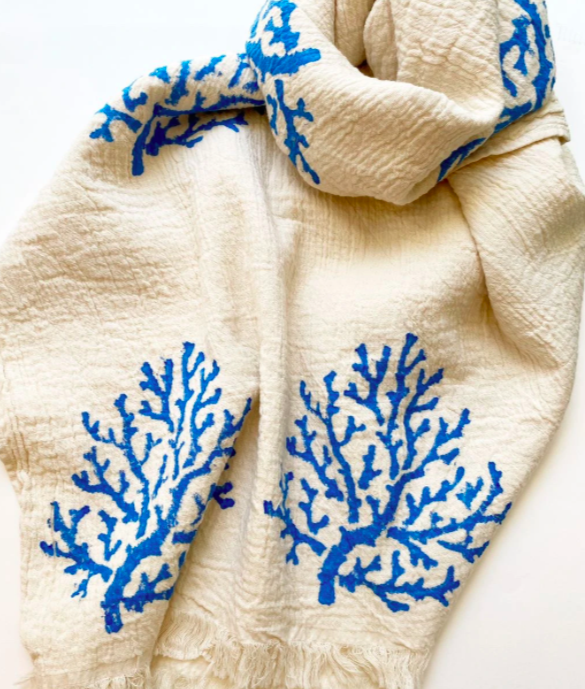 off white and blue scarf with embroidered trees throughout against a white background