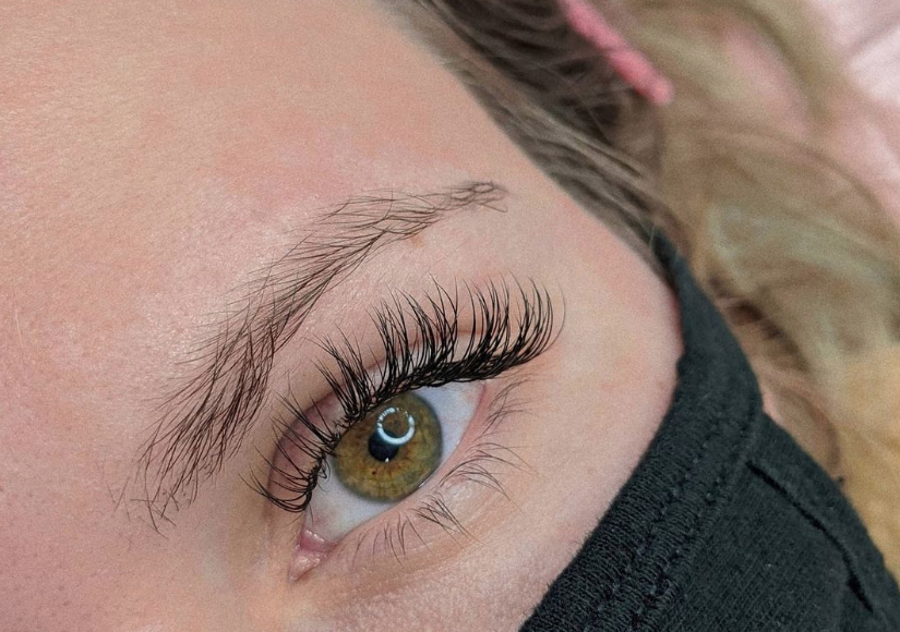 close up of someones eye with their eyelashes just recently done wearing a mask