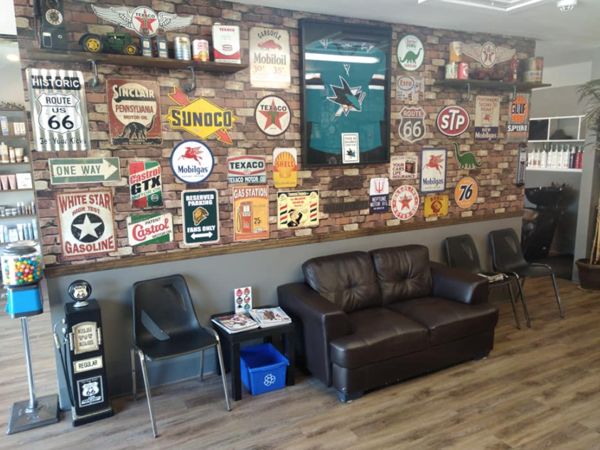 interior of a barber shop with many frames containing pictures on a wall in the reception area