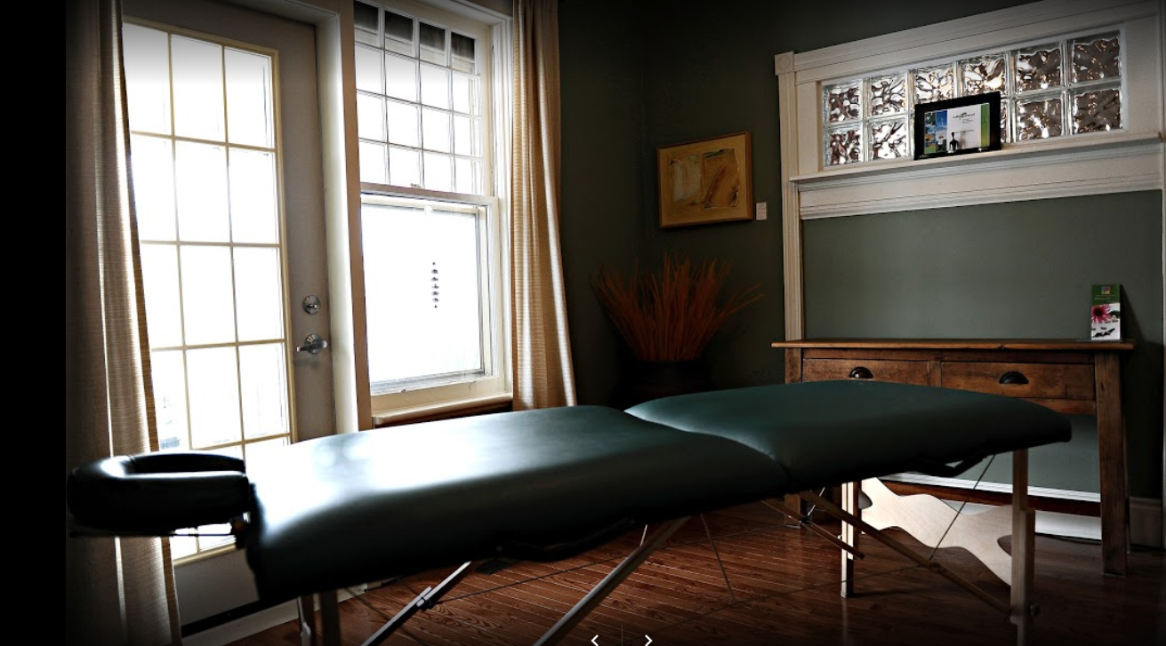 interior of a massage room with an unmade massage table on a bright day