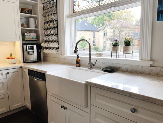 interior of a recently renovated kitchen with many white details