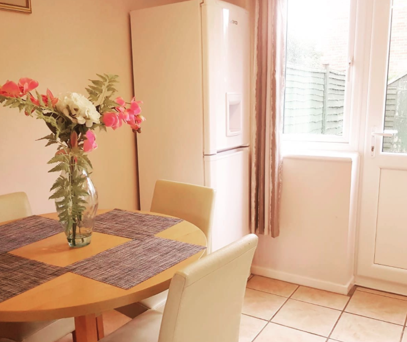 picture of freshly cleaned kitchen with flowers on the dining table on a sunny day