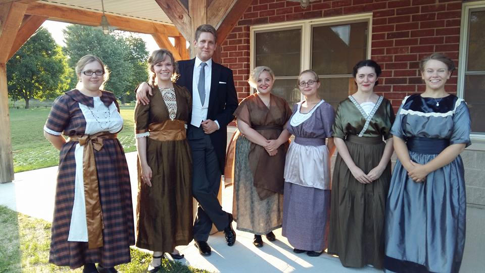 A group of employees in costume for pioneer style village