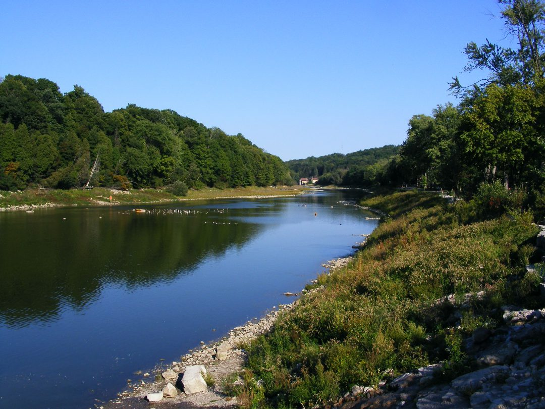 river outdoors surrounded by greenery and blue sky