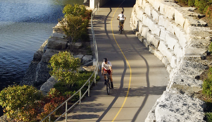 Bike trails along the river with two paths and two people
