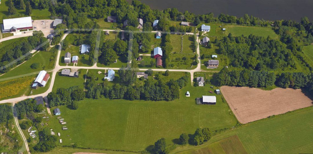 Aerial view of a Pioneer community with farms surrounding