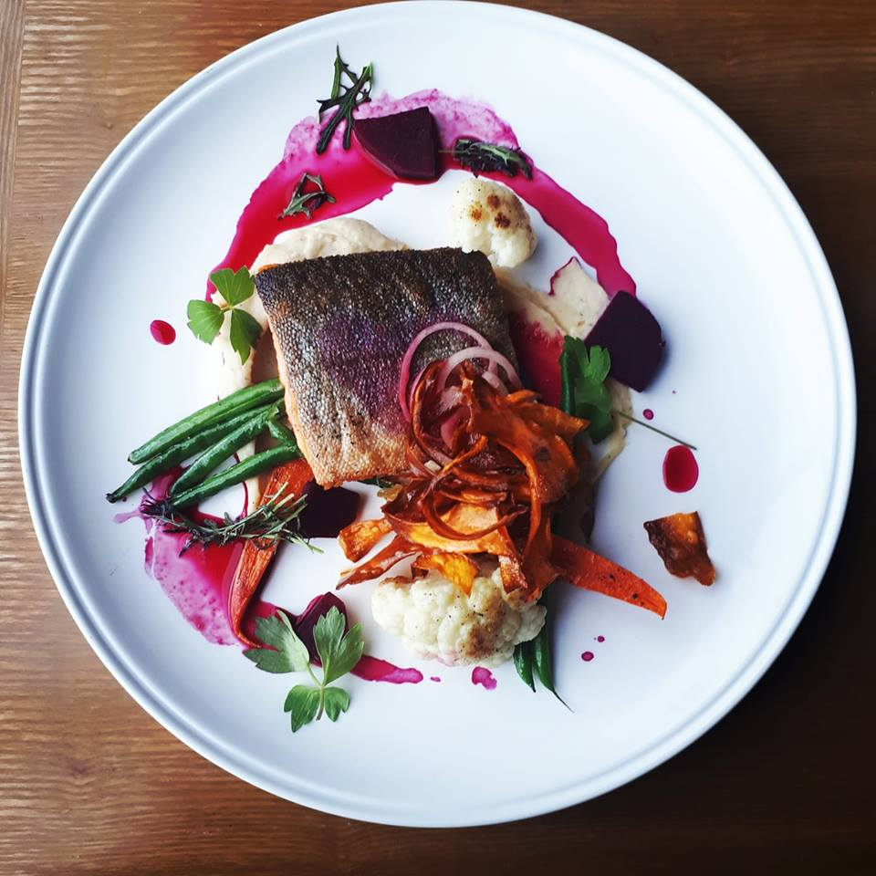 Arctic char with smoked potato puree, pickled shallots, beet root jus and crispy yams