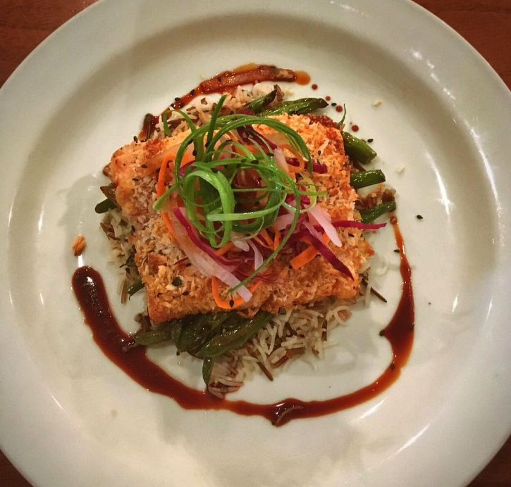 Sesame crusted trout topped with daikon slaw & ponzu sauce , served with veggies & rice