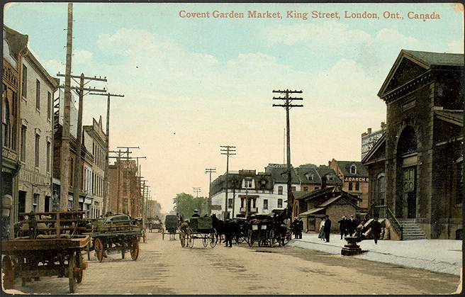 Historic street view with carts and buildings surrounding the road