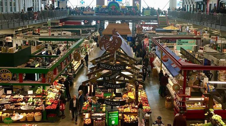 interior shot from the second floor of the covent garden market looking at vendors below